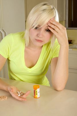 woman with prescription drugs