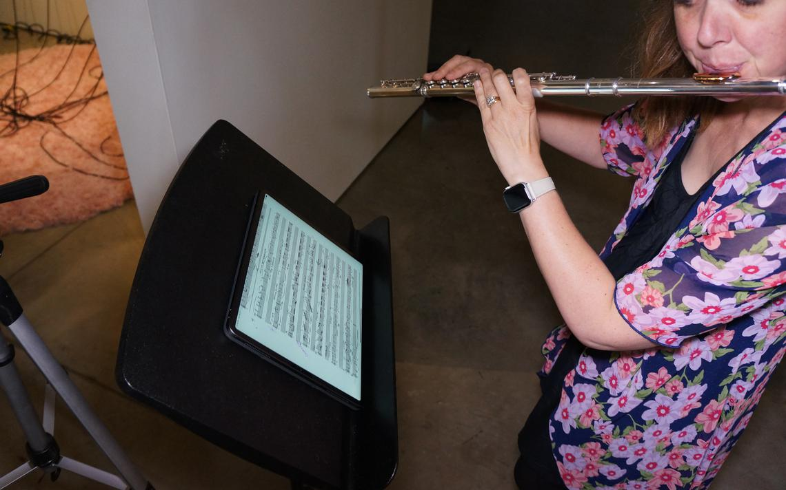 Technology was put to use in the project, allowing the flutist to focus on the music and allowing her to play continuously. Ethan Mickelson / The Arts Partnership