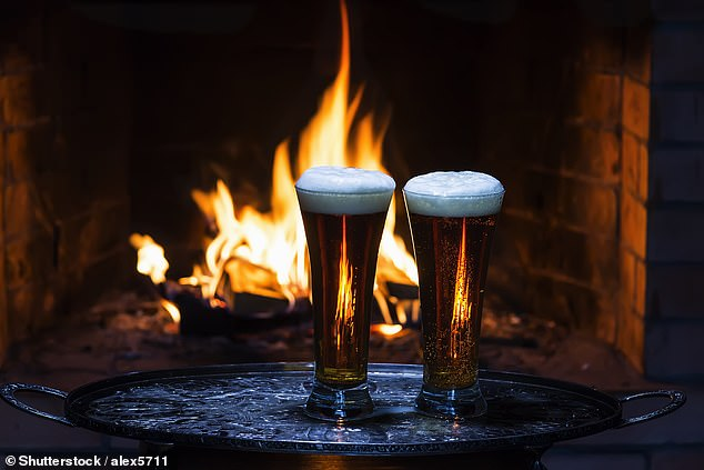 Many travellers love the warmth from a roaring fire in a London pub on a chilly day