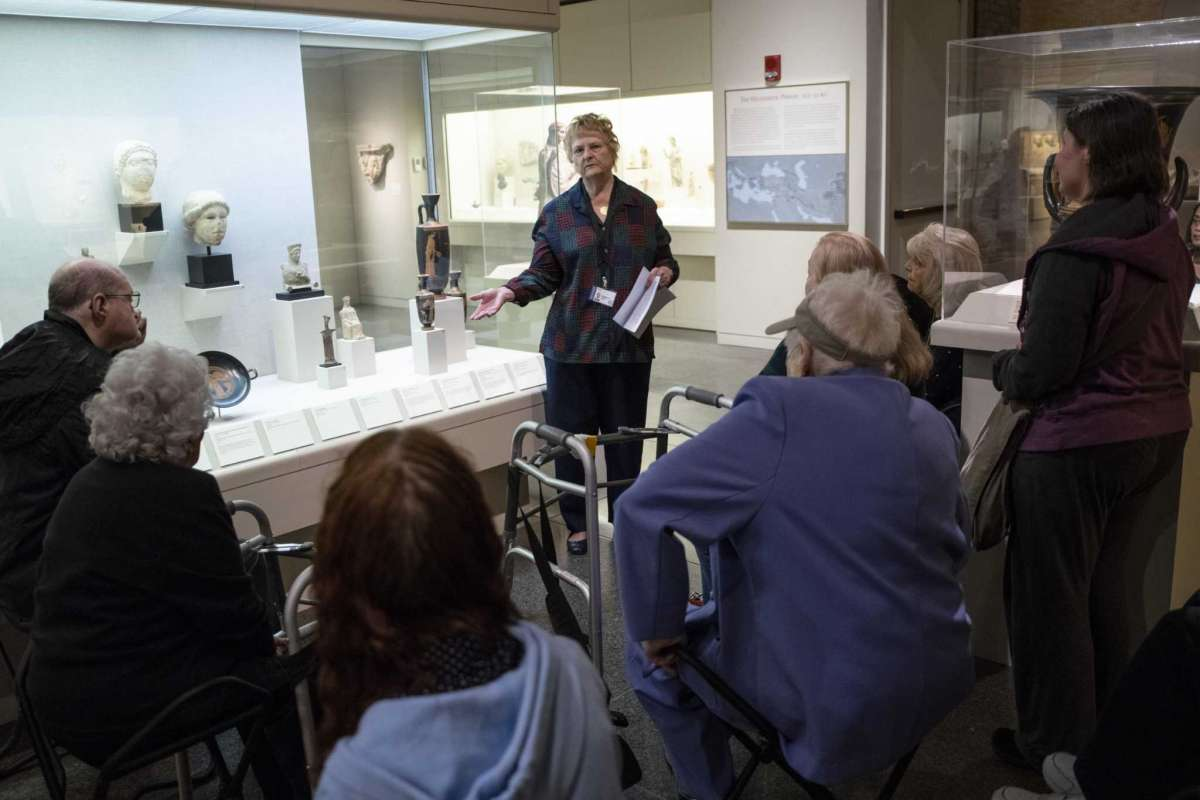 Susanne O'Brien, a docent at the San Antonio Museum of Art, describes the depiction of the Greek goddess Nike during a sensory tour on Saturday, March 7, 2020.