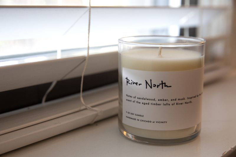 The River North candle is inspired by the rich scent of the aged timber lofts of River North, with notes of sandalwood, amber, and musk.