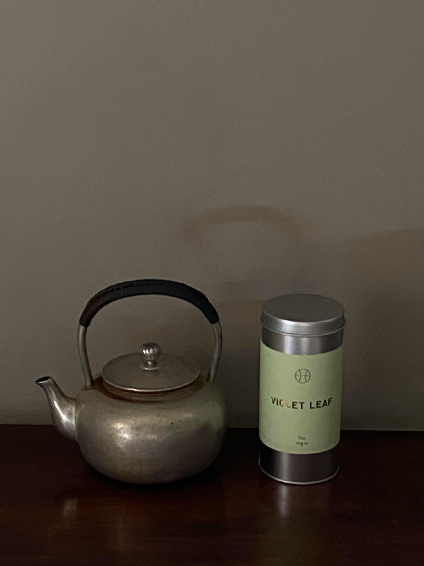 perfumer h jasmine tea on silver plate with silver tea pot