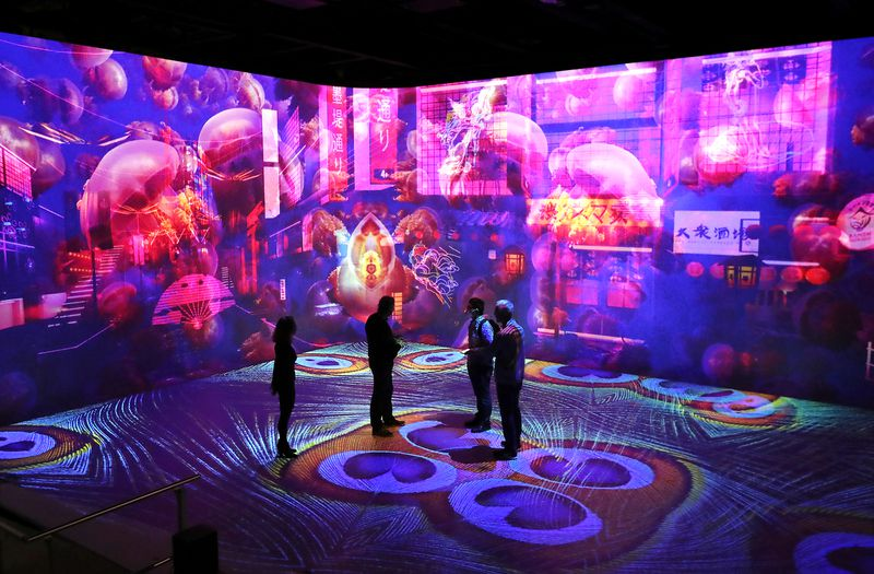 Visitors receive a glimpse of Illuminarium in Atlanta before its scheduled opening date in July. Curtis Compton / Curtis.Compton@ajc.com