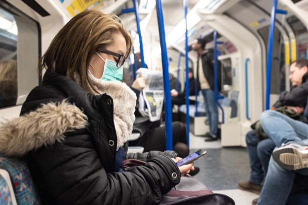 A woman wearing a facemark on the London Underground. PA Photo. Picture date: Wednesday February 26, 2020. See PA story HEALTH Coronavirus. Photo credit should read: Ian Hinchliffe/PA Wire