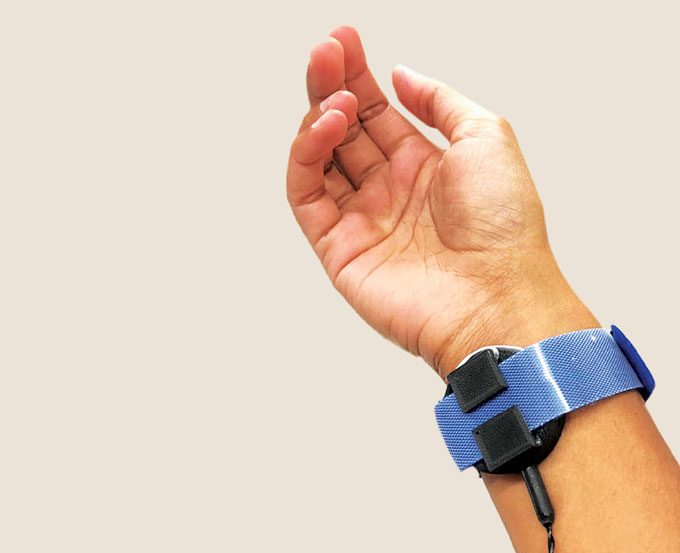 haptic feedback system that applied force near the elbow
